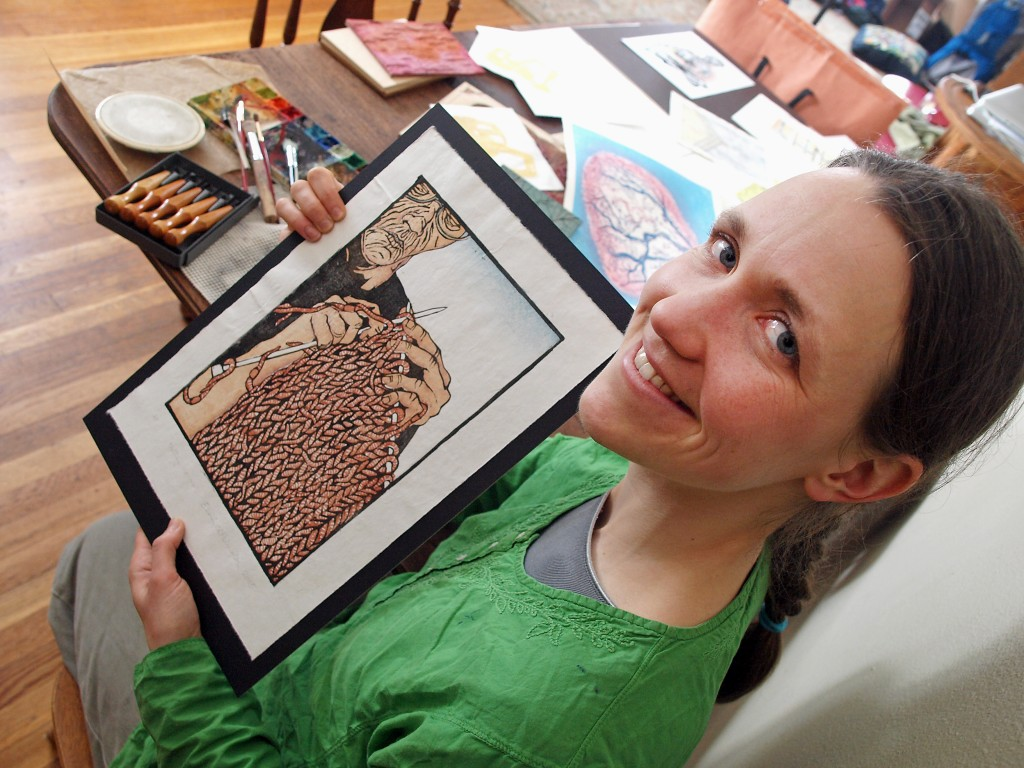 Emily Hoisington holds one of her wood block prints. Photo by Brad Stauffer